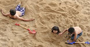 Children on beach playing in the sand-benefit-of-sand