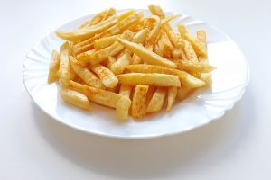 Plate of french fries-herbs-that-naturally-lowers-cholesterol