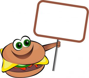 Smiling hamburger holding sign-how-to-get-your-kids-to-eat-vegetables