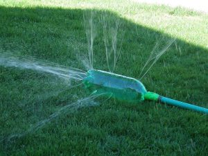 Plastic-bottle- attach -to-hose-water-the-lawn-gardening-with-plastic-bottles