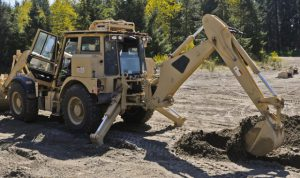 Excavator digging hole-Careers-in-irrigation