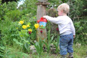 Organic Gardening For Kids-kid-watering-flowers